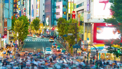 People cross the famous intersection in Shibuya, Tokyo, Japan one of the busiest Footage