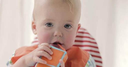 Cute boy drinking juice or milk from a packet Footage