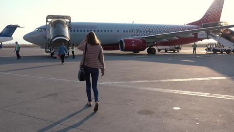 Woman going to plane an aerodrome Live Action