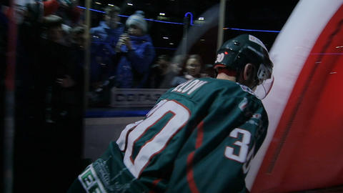 slow motion at projector lights player with back number skates to arena Live Action