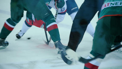 slow motion hockey players struggle for puck after face-off Live Action