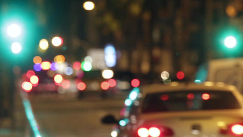 Blurred night traffic scene with traffic light changes Live Action