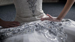 Girl ballerina touches tutu, sitting on floor, preparation for dance, ballet Footage