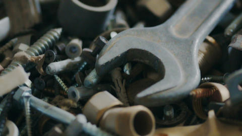 Closeup of various hardware fasteners, nuts, bolts, wrench and other details and Live Action