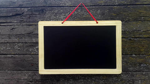 Empty black board against the background wooden wall GIF