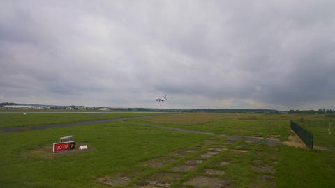 Airplane landing on runway in airport, reaching arrival destination, traveling Footage