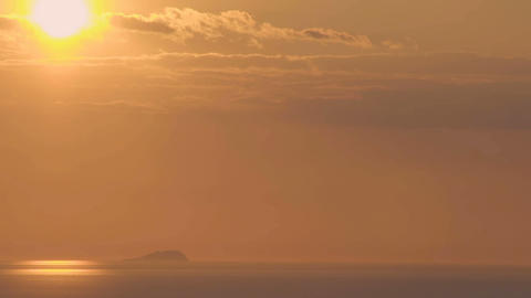 Sun sitting down across pink sky over glassed sea, amazing sunset seascape Footage
