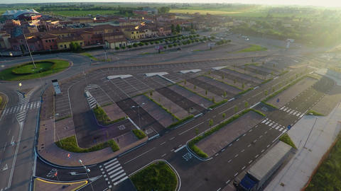 Drone flying over parking, checking free places at outlet village Mantova, Italy Footage