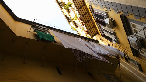 Classical Italian street with low cozy houses and laundry on balconies, sequence Footage