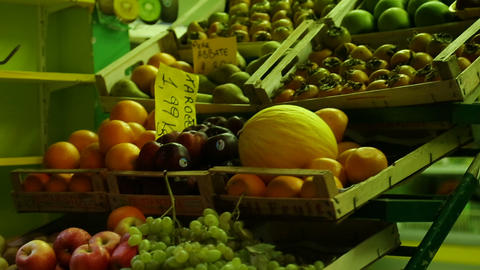 Street stalls offering variety of fresh fruit at affordable prices, retail trade Footage
