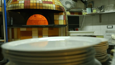 Fire burning in authentic oven for baking Italian pizza, traditional cuisine Live Action