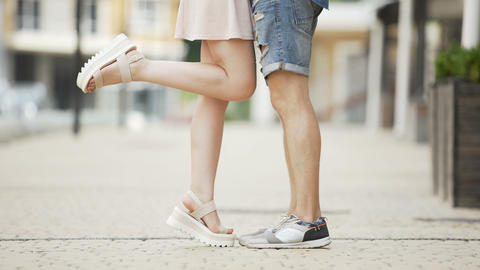 Legs of young man and woman approaching each other, romantic relationship, date Live Action