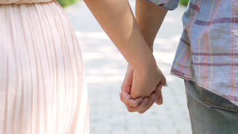 Man and woman holding hands tightly, romantic couple facing challenge together Footage
