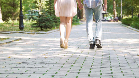Beautiful couple strolling in summer park, romantic relationship, first love Footage