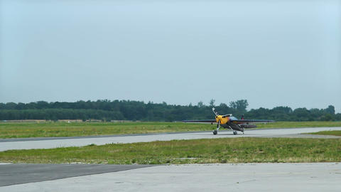 Light aircraft with propeller moving along runway, getting ready to take-off Live Action