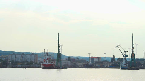 View from boat passing port docks and ships, seaside industrial city, export Footage