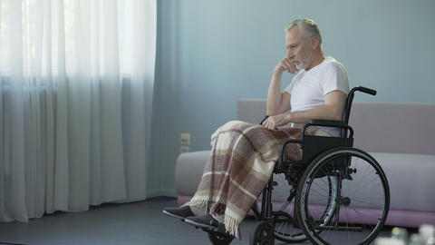 Elderly man in wheelchair deciding to move forward, strong will for recovery Footage