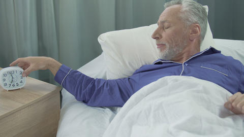 Full of strength and energy man waking up in his cozy bed rejoicing to new day Live Action