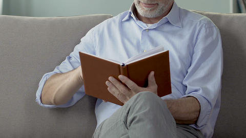 Retired man leafing through notebook, checking retirement plans, leisure time Footage