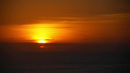 "Sunrise at the seashore dark orange sun coming out of the sea 46l - 3'16"" Footage"