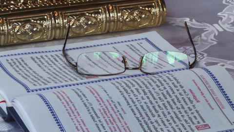 Eyeglasses sitting on a bible on the table in front of the altar 1d Footage