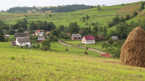 Beautiful green hills and village in Carpathians, Ukraine Footage