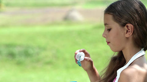 Attractive girl blowing soap bubbles Footage