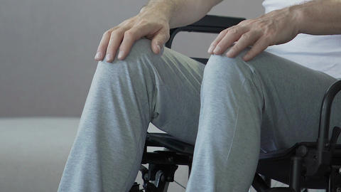 Feet of paralyzed male sitting in wheelchair socially vulnerable disabled person Live Action