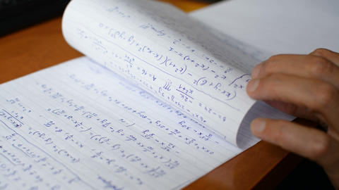 African american student hand writing math calculus formulas text on exam paper Footage
