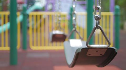 Empty Children's swing in the playground ビデオ