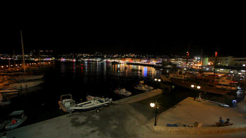 Beautiful night sea landscape. Greece. Bright colorful lights of the coast are Live Action