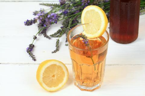 Homemade lavender syrup in a bottle and lemonade フォト