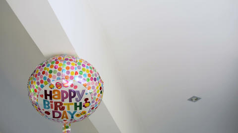 Happy Birthday celebration colorful party balloon is stuck at the ceiling Footage
