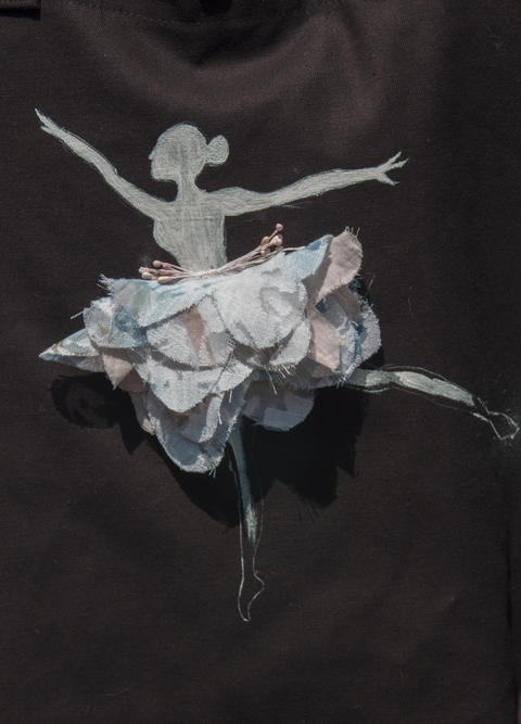 Textile ballerina on a dark fabric Photo