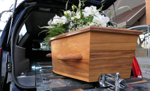 closeup shot of a colorful casket in a hearse or chapel before funeral or burial Fotografía