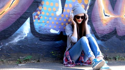 Teenage girl on the street listening to music 영상물