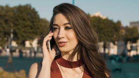 Beautiful Brunette Girl Talking by Phone Footage