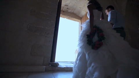 The bride and groom leave after the wedding from the old church. Wedding day Footage