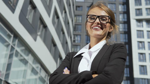Successful Businesswoman in front of Corporation Footage