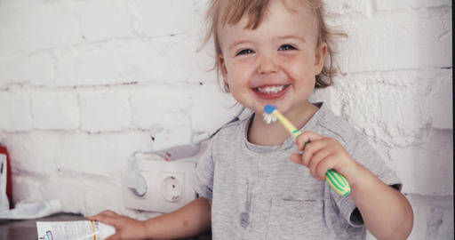 Baby boy brushing his teeth with a toothbrush Footage