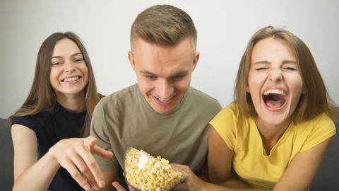 Lovely Teens Watch Comedy Footage