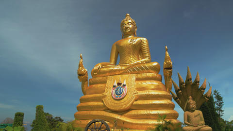 sculpture of the golden buddha. travel to Asia and a tourist place. religious Live Action
