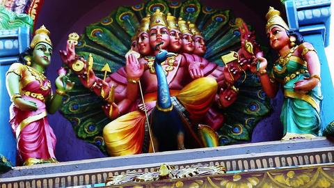 A Statue of Lord Murugan the Hindu goddess - Exterior Traditional Hindu temple, Footage