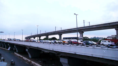Time lapse - Cars, Motorbikes and Bus Passing Over Bridge, City rush hour Footage