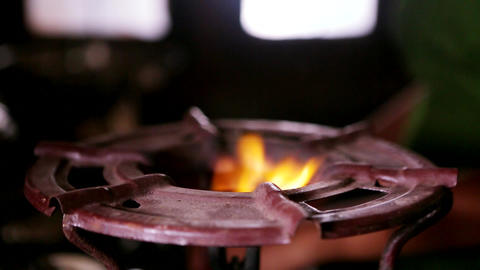 Gas fire burns, Natural gas inflammation in stove burner, close up view Footage
