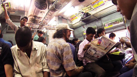 People travel on a busy local train in Mumbai Live Action