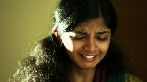 Young girl or woman sad face crying in the home Live Action
