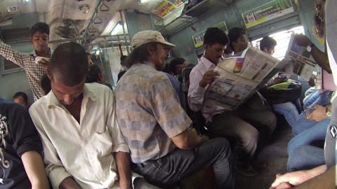 Commuters Travel On The Local Train In Mumbai Live Action