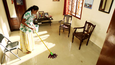Portrait Of Happy Woman Doing Chores Cleaning Floor At Home Footage