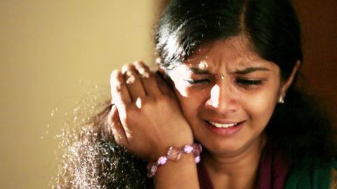 Sad woman crying at home at night Live Action